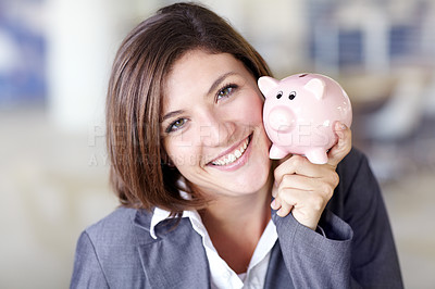 Buy stock photo Portrait of an attractive businesswoman holding a piggybank