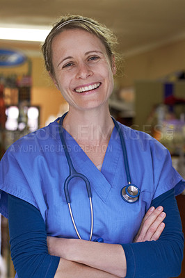 Buy stock photo Portrait of a happy veterinarian standing with her arms folded