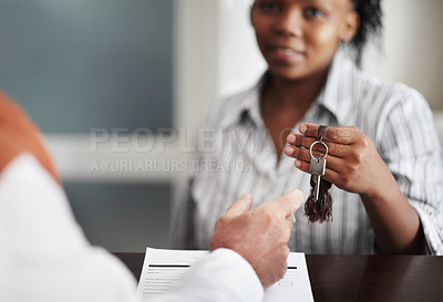 Buy stock photo A receptionist handing over the hotel room keys to a senior patron