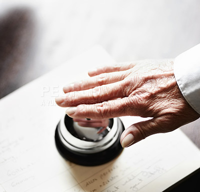 Buy stock photo A senior woman ringing the bell at a hotel reception desk