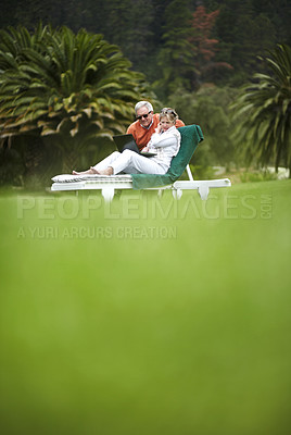 Buy stock photo A senior couple using a laptop while on vacation - Copyspace