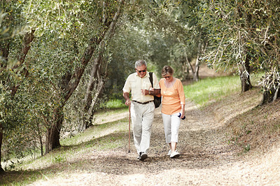 Buy stock photo A senior couple out for a walk in the forest together