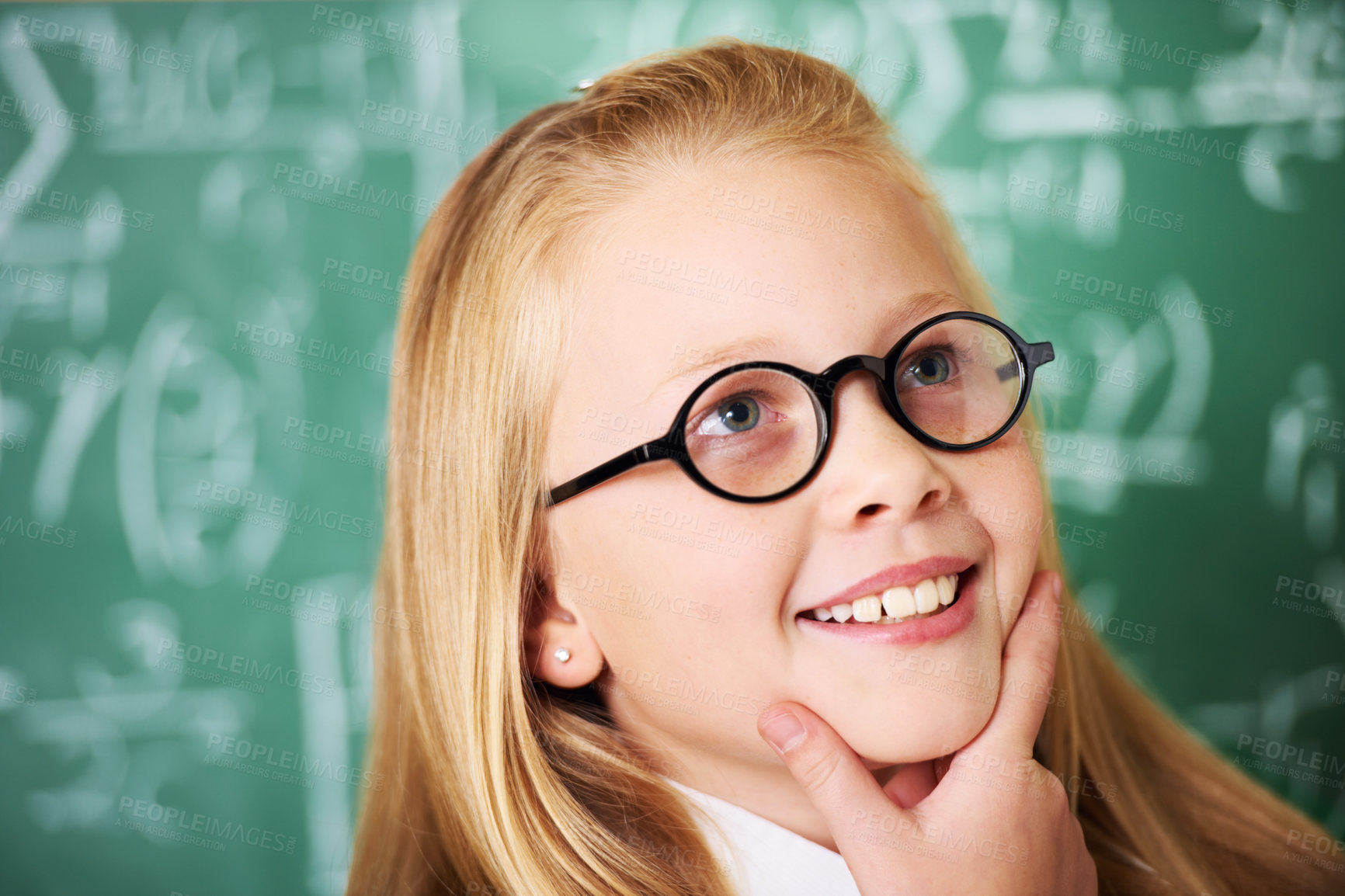 Buy stock photo A cute blonde girl looking pensive in class