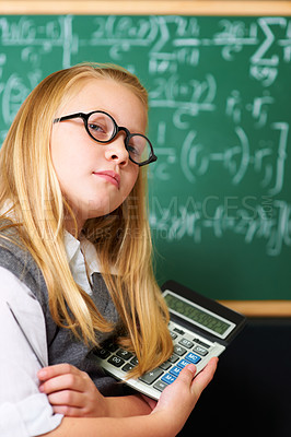 Buy stock photo Portrait of a cute blonde girl holding a pen and calculator in class
