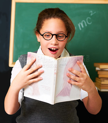 Buy stock photo A cute brunette girl reading a book in class