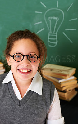 Buy stock photo Portrait of a cute brunette girl standing infront of the chalkboard in class