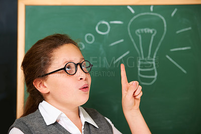 Buy stock photo A cute brunette girl working stuff out with her mind while in class