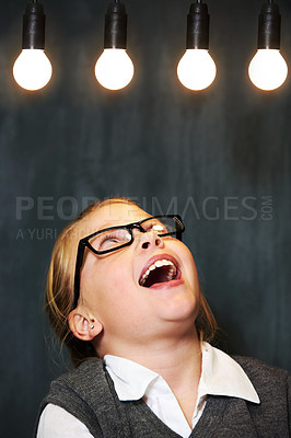 Buy stock photo A cute blonde girl looking up at three lightbulbs in class