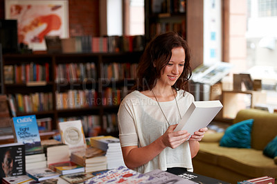 Buy stock photo A young woman spending time browsing for books in a bookshop