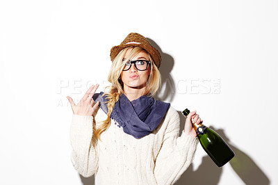 Buy stock photo A gorgeous young woman holding a bottle of champagne and gesturing with her hand