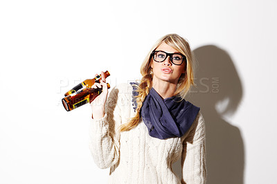 Buy stock photo A gorgeous young woman with two beers against a white background