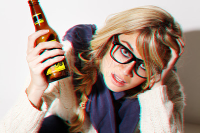 Buy stock photo A young woman sitting on the floor with a beer in her hand