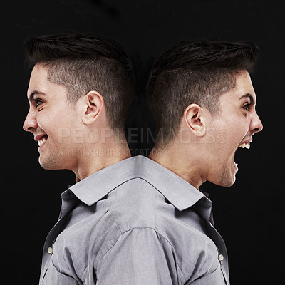 Buy stock photo Studio shot of a young man showing two sides of his personality
