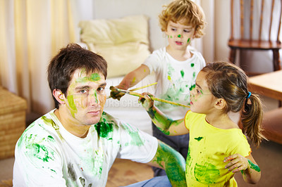 Buy stock photo Shot of a dad being painted by his children