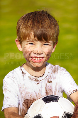 Buy stock photo Portrait of a muddy little boy holding a soccer ball