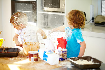 Buy stock photo A little boy covered in dough and flour