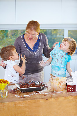 Buy stock photo Two boys being scolded by their mother for messing up her kitchen