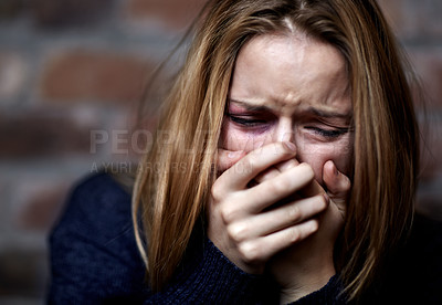 Buy stock photo Abused young woman crying hard and covering her mouth