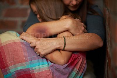 Buy stock photo Abused woman embracing her frightened daughter