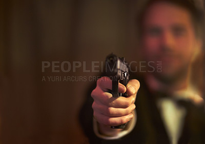 Buy stock photo View of a man holding a gun and pointing at you