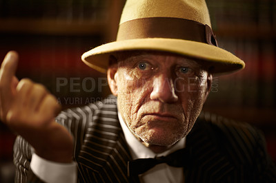 Buy stock photo Closeup of an aged mob boss wearing a hat and looking serious