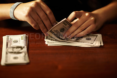 Buy stock photo Cropped view of a woman counting banknotes
