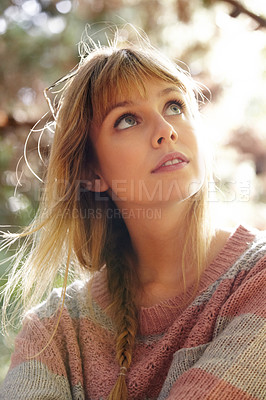 Buy stock photo A closeup shot of a pretty girl sitting among some trees