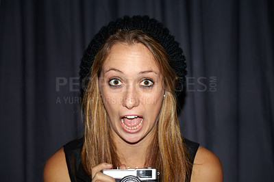 Buy stock photo Portrait of a shocked-looking girl holding a vintage camera