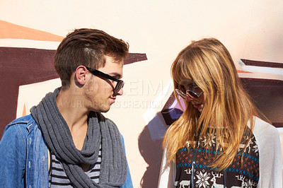 Buy stock photo Two good looking young people standing face to face outside
