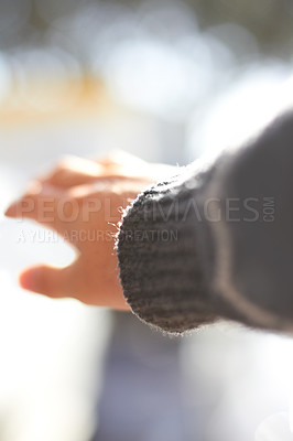 Buy stock photo A closeup shot of a hand reaching out into the sunshine