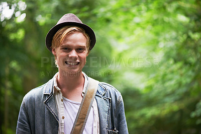 Buy stock photo Portrait of a handsome young man standing in a forest