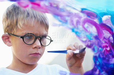 Buy stock photo Focused little boy painting on glass and creating artwork