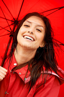 Buy stock photo Closeup of a beautiful young woman laughing while wearing a red raincoat and holding an umbrella
