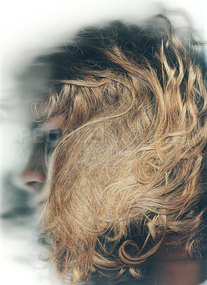 Buy stock photo Profile shot of a young man with his face obscured by his long, curly hair