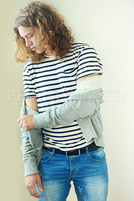 Buy stock photo Casual young man with long, curly hair