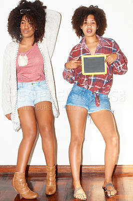 Buy stock photo Young African hipsters standing and holding a blank slate