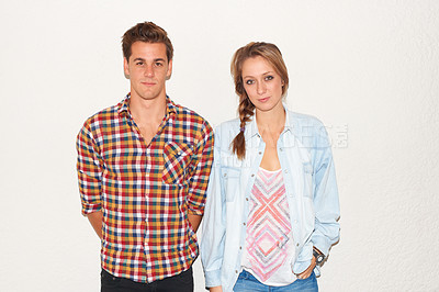 Buy stock photo Stylish young hipster couple standing against a white wall