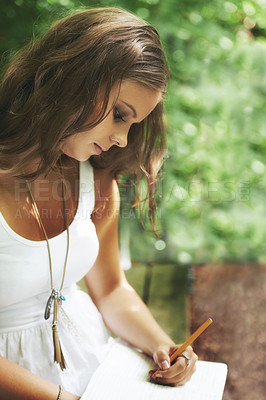 Buy stock photo A beautiful woman sitting in the forest and writing in her journal