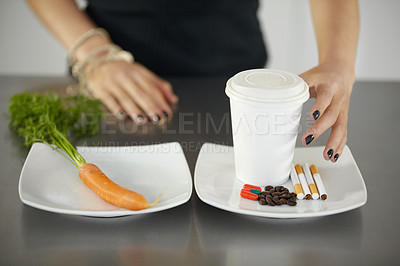 Buy stock photo A young woman choosing between healthy and unhealthy nutrition