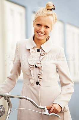 Buy stock photo A gorgeous young woman in a jacket standing with a vintage bicycle