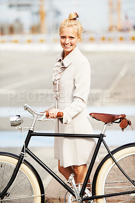 Buy stock photo A gorgeous young blonde woman crossing the street with her bicycle