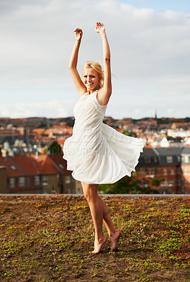 Buy stock photo A gorgeous young woman twirling outside