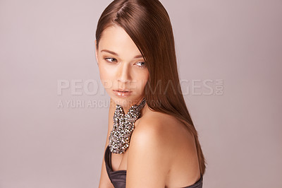 Buy stock photo Beautiful young woman wearing a beaded necklace against a pink background