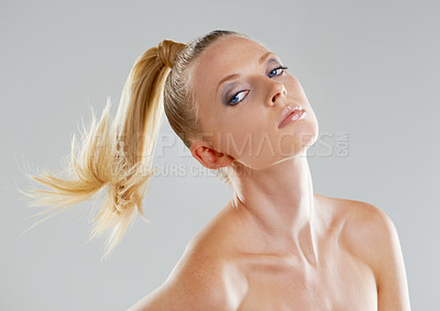 Buy stock photo Portrait of a beautiful young woman with a ponytail against a gray background