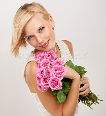 Buy stock photo Portrait of an attractive young woman holding a bunch of flowers