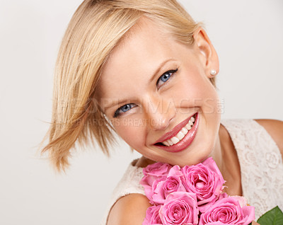Buy stock photo Closeup portrait of an attractive young woman with pink roses