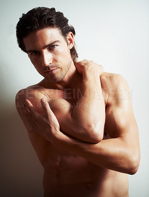Buy stock photo Portrait of a sexy semi-nude young man leaning against a wall