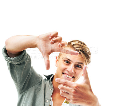 Buy stock photo Studio portrait of a young man framing the camera with his fingers isolated on white