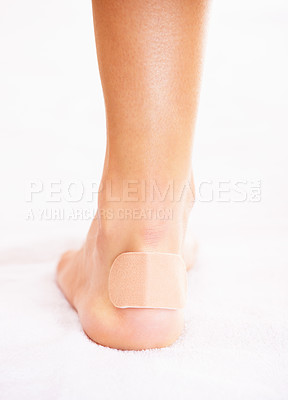 Buy stock photo Closeup of a woman's heel with a blister plaster on