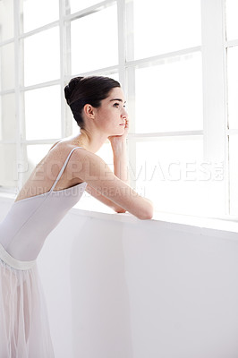 Buy stock photo Beautiful young ballerina looking out the window
